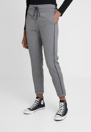 POPPIN PIED - Tracksuit bottoms - black