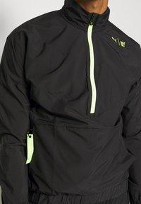Puma - TRAIN FIRST MILE XTREME JACKET - Training jacket - black - 4