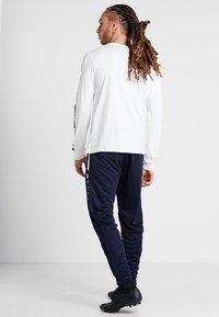 JAKO - ACTIVE - Teplákové kalhoty - navy/white - 2