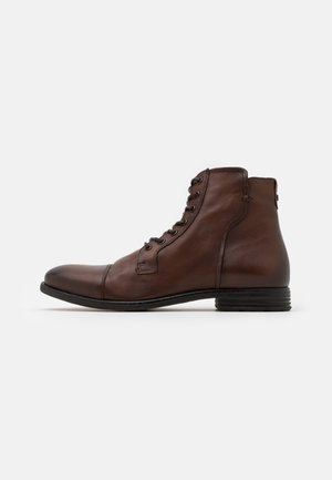 STEURSTRAAT - Lace-up ankle boots - dark brown