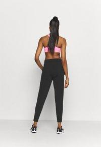 Nike Performance - WARM PANT RUNWAY - Tracksuit bottoms - black/reflective silver - 2