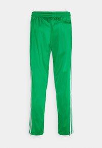 adidas Originals - ADICOLOR CLASSICS FIREBIRD PRIMEBLUE TRACK PANTS - Tracksuit bottoms - green - 1