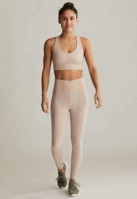 OYSHO - Medium support sports bra - beige - 1