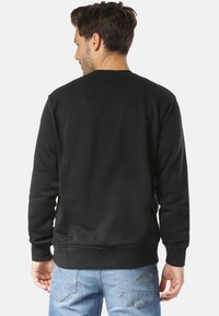 Nike Sportswear - REGULAR FIT - Sweater - black - 1