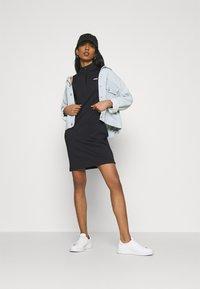 Fila - CEARA TIGHT DRESS - Pouzdrové šaty - black - 1