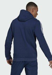 adidas Performance - TIRO  SWEAT HOODIE - Luvtröja - blue - 1