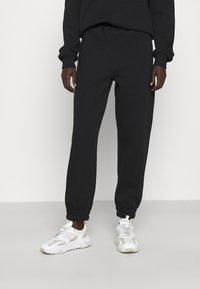 Stieglitz - Teplákové kalhoty - black - 2