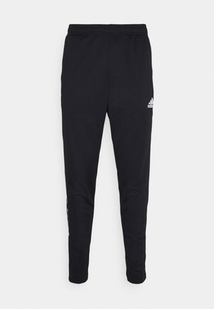 TIRO - Tracksuit bottoms - black