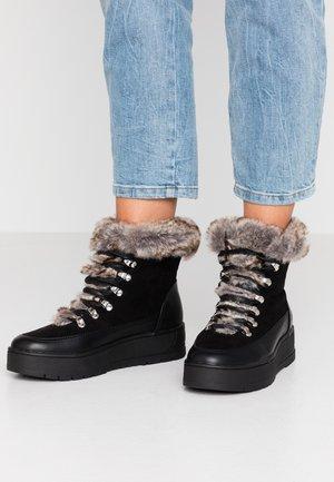 MIRTA - Kotníkové boty na platformě - black