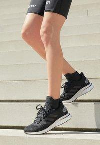 adidas Performance - SUPERNOVA - Zapatillas de running neutras - core black/grey six/silver metallic - 5