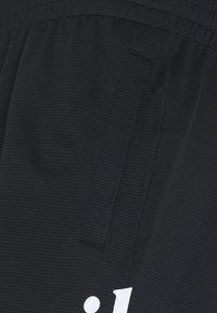 Nike SB - SUNDAY UNISEX - Tracksuit bottoms - black/white - 2