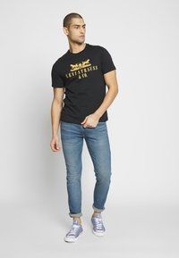 Levi's® - 512™ SLIM TAPER  - Jeans slim fit - south beach sand dune - 1