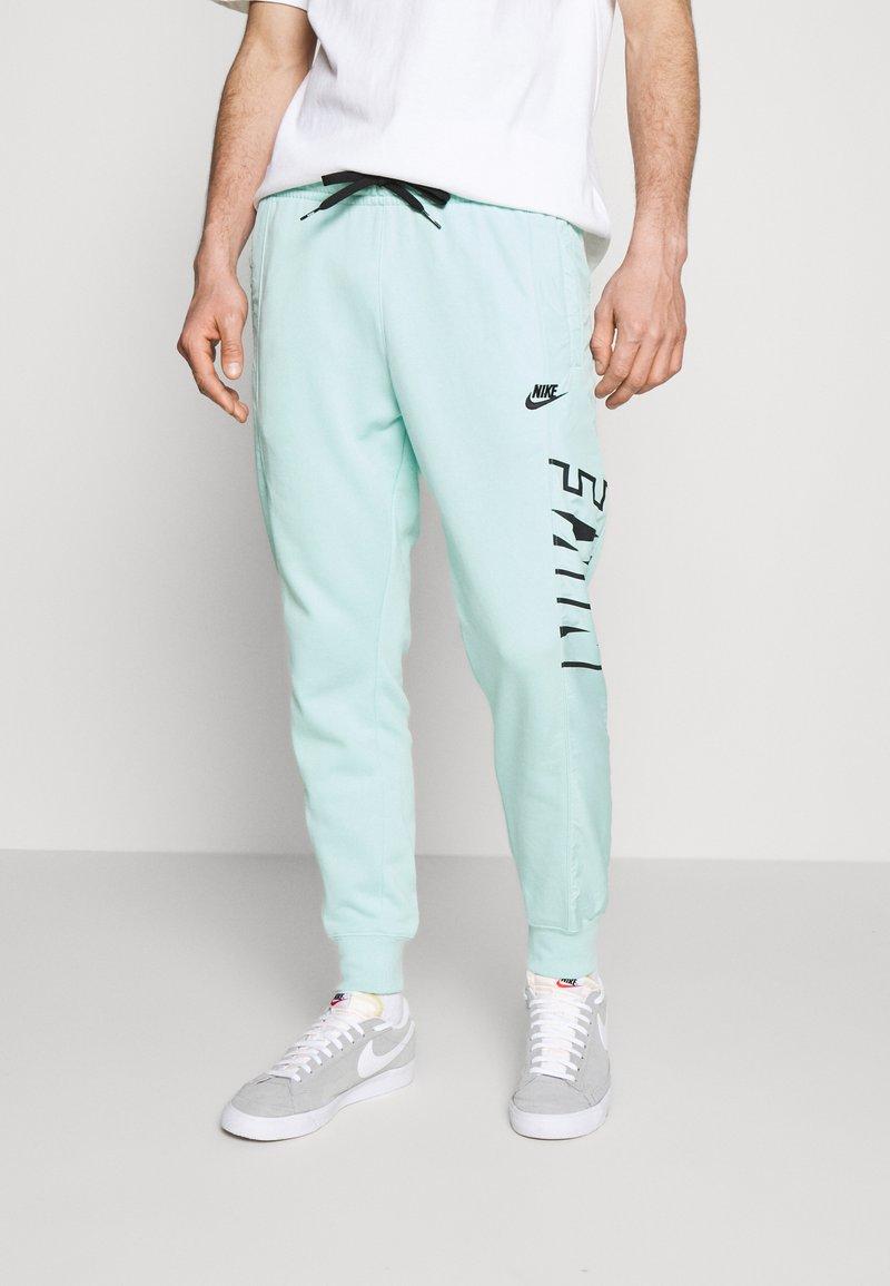 Nike Sportswear - Tracksuit bottoms - light dew/black