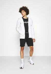 CLOSURE London - BRANDED WAISTBAND  - Shorts - black - 1