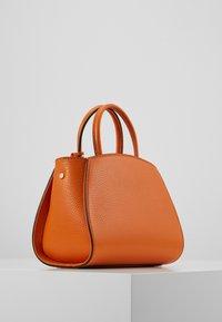 Coccinelle - CONCRETE HANDBAG - Handbag - ginger - 1