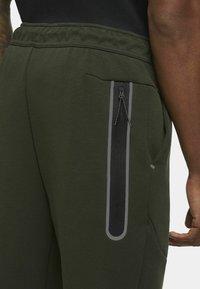 Nike Sportswear - Tracksuit bottoms - sequoia/black - 3