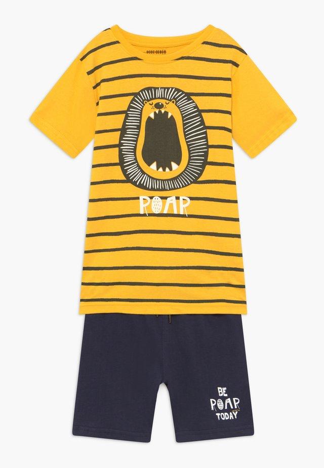 SET - Pantaloni sportivi - yellow
