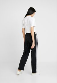 adidas Originals - FIREBIRD ADICOLOR TRACK PANTS - Träningsbyxor - black - 3