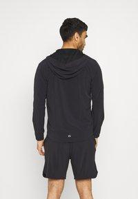 Calvin Klein Performance - PRIDE WINDJACKET - Training jacket - black - 2