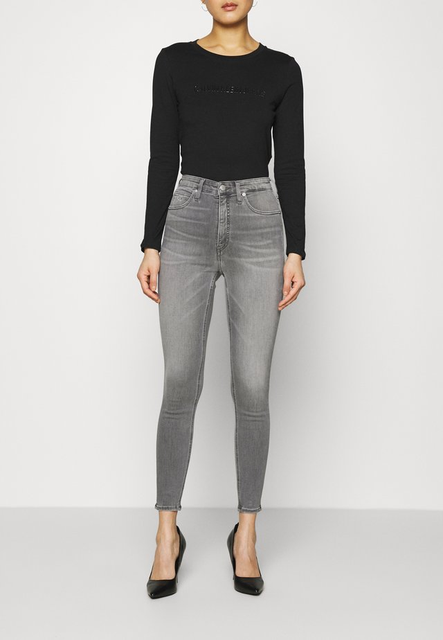 HIGH RISE SUPER SKINNY ANKLE - Jeans Skinny Fit - denim black