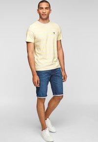 s.Oliver - Print T-shirt - light yellow stripes - 1