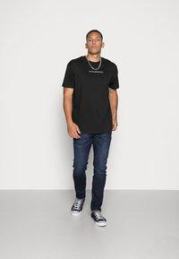 Night Addict - T-shirt imprimé - black - 1