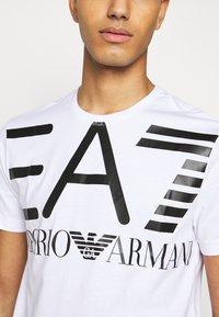 EA7 Emporio Armani - Print T-shirt - white - 7