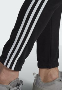 adidas Performance - ESSENTIALS FRENCH TERRY TAPERED 3-STRIPES JOGGERS - Pantalones deportivos - black - 4