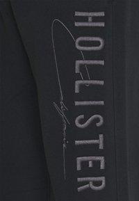 Hollister Co. - MODERN TECH - Tracksuit bottoms - black - 2