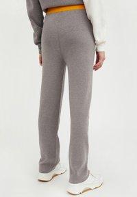 Finn Flare - Tracksuit bottoms - grey melange - 0