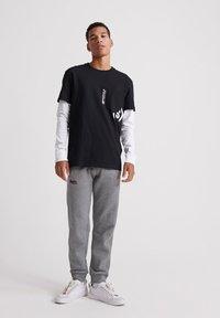 Superdry - Long sleeved top - black - 1