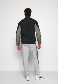 adidas Performance - CUT - Tracksuit bottoms - medium grey heather/black - 2