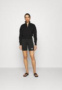 Calvin Klein Jeans - BACK REFLECTIVE LOGO HALF ZIP - Sweatshirt - black - 1