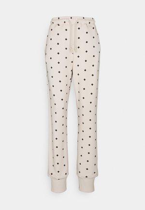TANYA - Pantalon de survêtement - stone