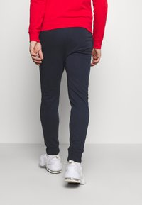 Champion - HOODED FULL ZIP SUIT - Tracksuit - red/dark blue - 4