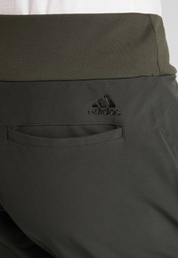 adidas Golf - QUILTED PANT - Trousers - legend earth
