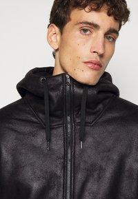 EA7 Emporio Armani - GIUBBOTTO - Leather jacket - black - 5