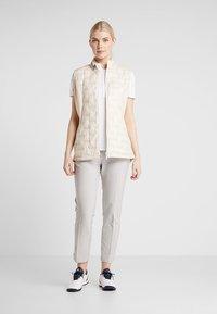 adidas Golf - MICRODOT SHORT SLEEVE - Poloshirt - white - 1