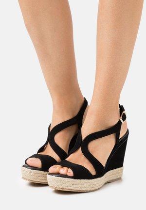 TELMA - Sandály na platformě - black