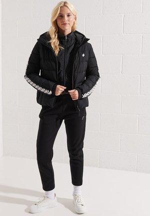 HOODED SPIRIT TAPED PUFFER  - Winter jacket - black