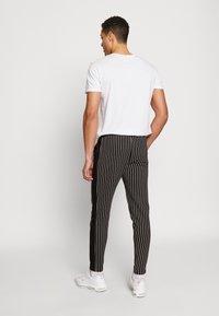 Burton Menswear London - PINSTRIPE - Tracksuit bottoms - black - 2