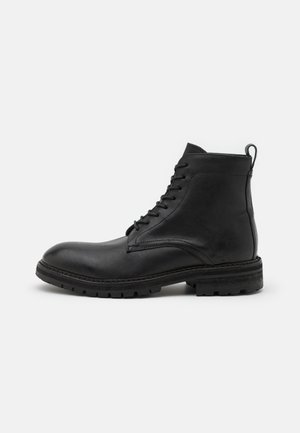 HOWDEN - Lace-up ankle boots - black
