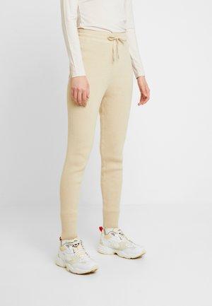 STINE - Trousers - sand melange