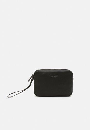 WARMTH COMPACT CASE UNISEX - Handbag - black