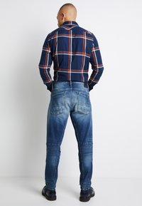 G-Star - SCUTAR 3D SLIM TAPERED - Jeans Tapered Fit - elto pure stretch denim- antic faded baum blue - 3