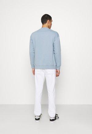 JET FIT - Jeans slim fit - denim white