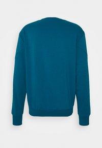 Puma - REBEL CREW SMALL LOGO - Sweatshirt - digi blue - 6