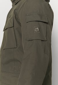 Jack Wolfskin - GLACIER CANYON - Winter coat - brownstone - 5