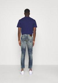 Tigha - BILLY THE KID DESTROYED - Slim fit jeans - vintage mid blue - 2