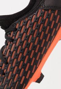Puma - FUTURE 6.4 FG/AG - Moulded stud football boots - black/white/orange - 2